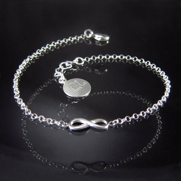 Silver bracelet with infinity symbol.