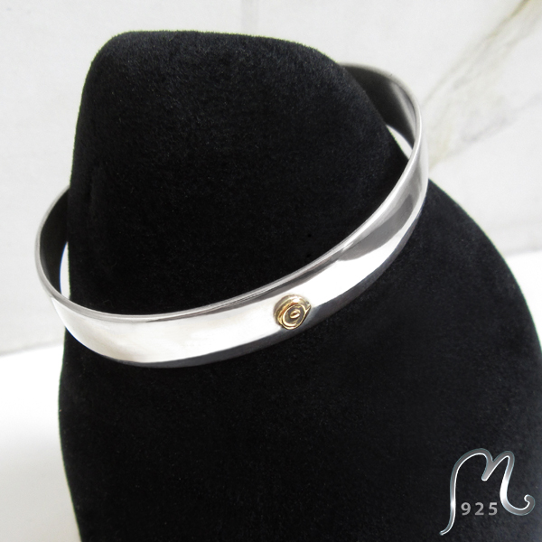 Domed silver cuff. 1 cm. 18 c. gold detail.