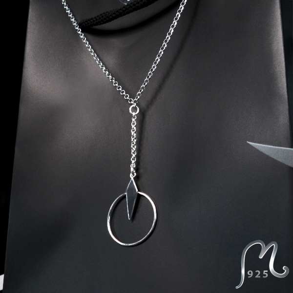 Geometric silver necklace with a ring.