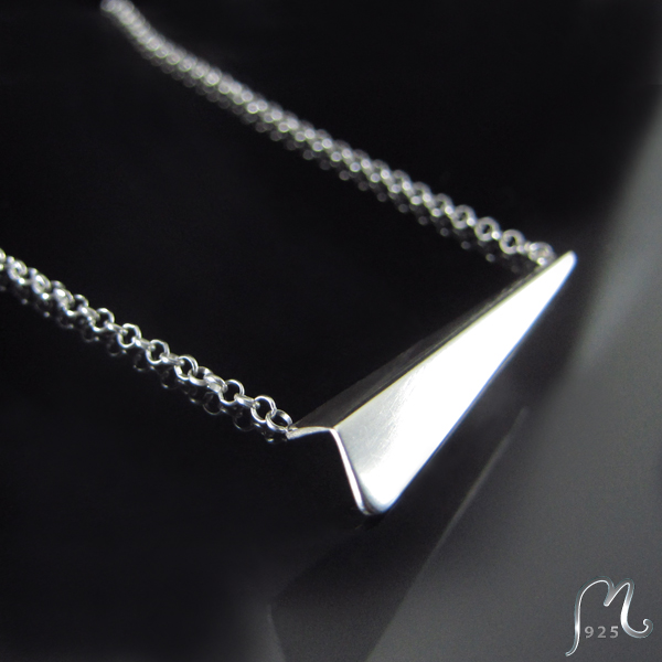 Folded silver necklace.