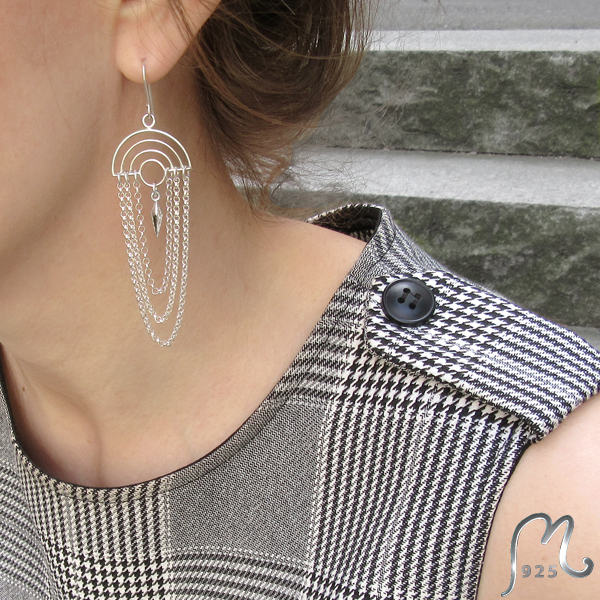 Long silver earrings with rivet.