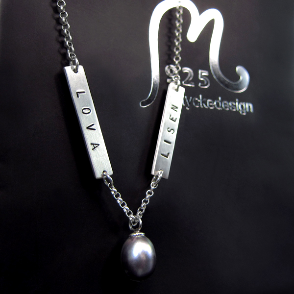 Personalized silver necklace. Two tags and a sweet water pearl. Engraving included.
