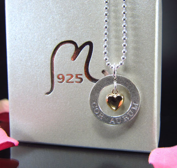 Jewelry for mom. Heart of gold. Silver and 18 c. gold. Engraving included.