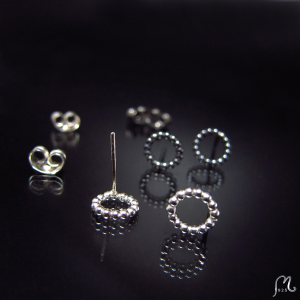 Small rounded silver studs.
