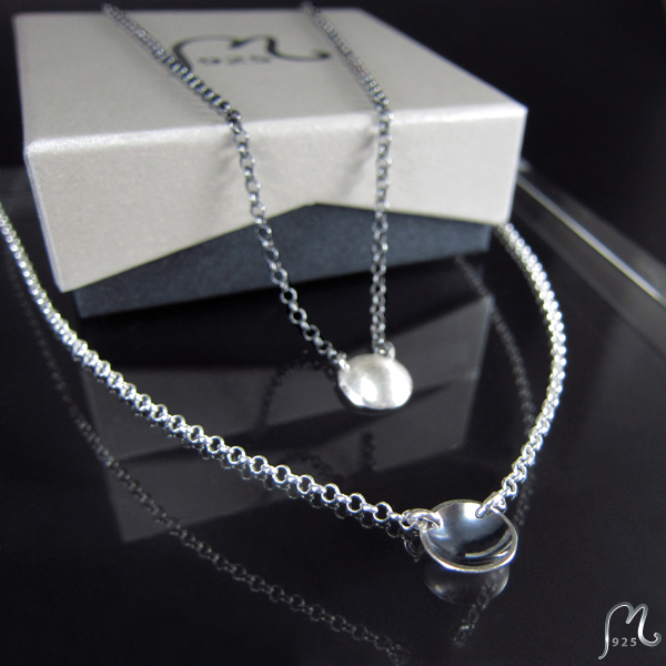 Discrete silver necklace with a bowl.