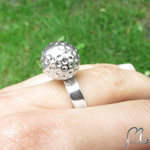 Silver ring with golf bal. NEW!