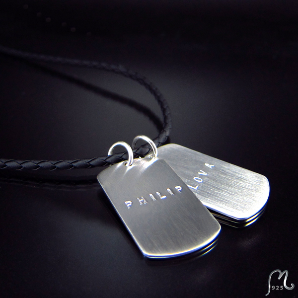 ID necklace w. 2 tags. Silver & string.