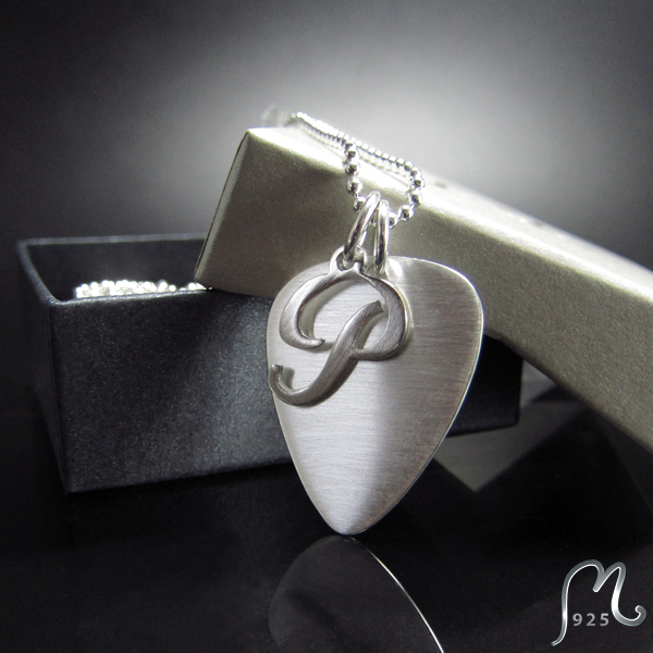 Personalized silver plectrum necklace. Engraving included.