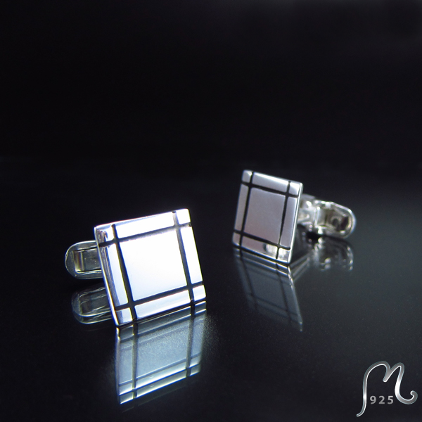 Square silver cuff links with enamel.