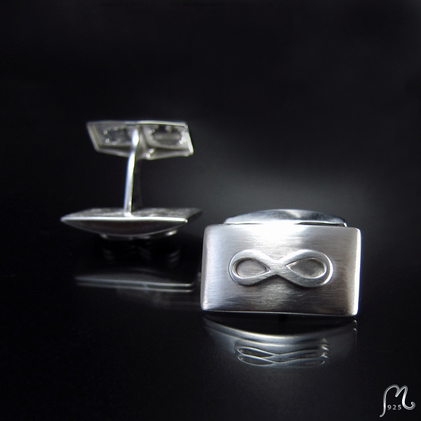 Cufflinks in silver. Boat shaped with infinity symbol.
