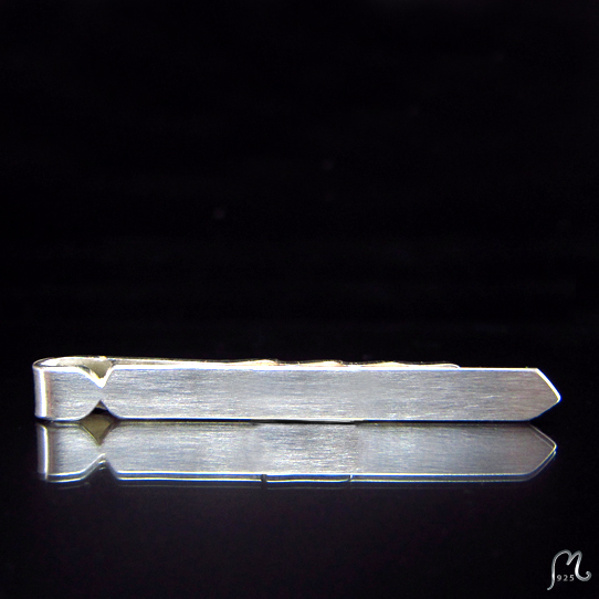 Tie shaped tie clip in silver.