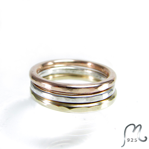 Wedding- or Engagement ring in silver or 9 c. gold. Hammered halo.