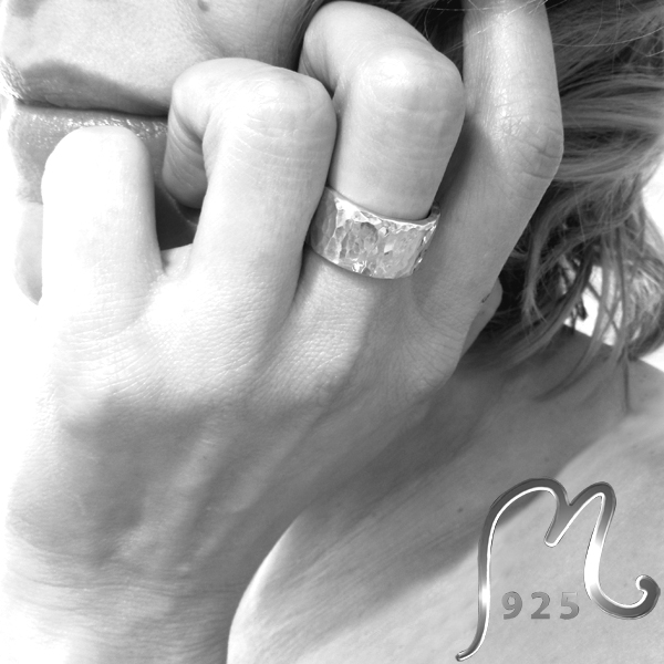 Champagne. Wide, hammered silver ring.
