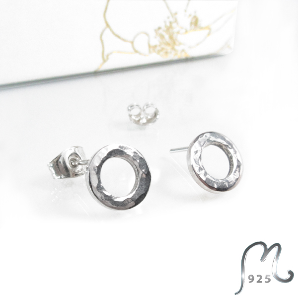 Champagne. Hammered silver studs.