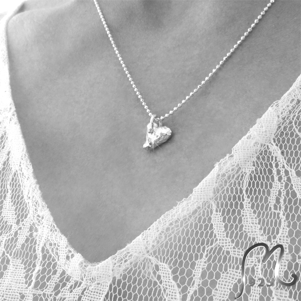 Champagne. Silver necklace with connected hearts.