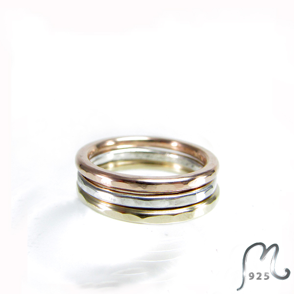 Champagne. Thin, hammered ring in silver or 9 c. gold.