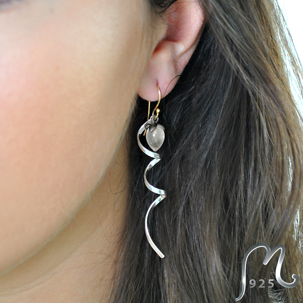 Spiral earrings with moonstone drops.