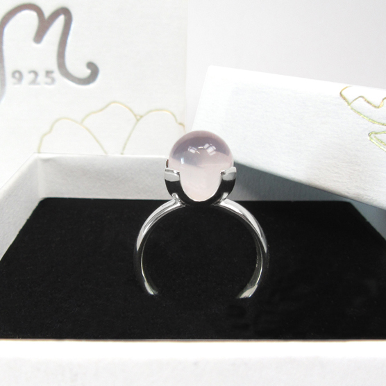 Silver ring with pink gemstone.