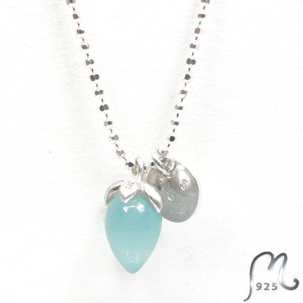 Necklace with blue gemstone.